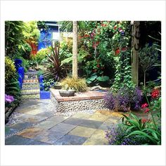 Moroccan-inspired courtyard with tiled steps, pebble inserts and tropical style planting