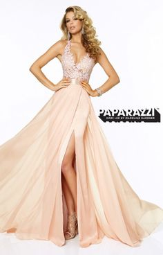 Paparazzi 97018 is a daring dress that shows a little extra skin. The lace bodice has a sheer layer right above the shining belt. The chiffon skirt has a daring split up the front. The open back completes the dress. Paparazzi 97018 is sure to wow the crowd!
