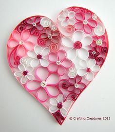 Beautiful quilled paper heart and flowers for Valentine's Day or any day of Spring! (Instructions available from the talented artist, Cecilia Louie of Crafting Creatures, for 5 dollars here: http://www.craftsy.com/pattern/paper-crafts/quilling-flowers/13908.)