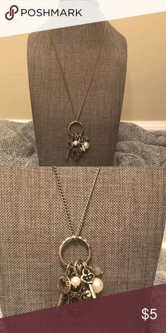 Long key and charm necklace This necklace looks great with any outfit. Key and charm necklace is a very simple look Maurices Jewelry Necklaces