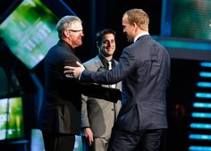 Peyton Manning accepting the Comeback Player of the Year Award at the 2013 NFL Honors, with Brett Favre and Aaron Rodgers