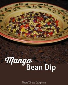 This Mango Bean Dip is a light and healthy appetizer recipe, and it's pretty too!  Most of the ingredients you can keep on hand in your pantry.  It travels well and is great to serve at a party or Summer BBQ! Recipe from makedinnereasy.com