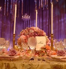 Alternating high and low arrangements on the table adds to the depth and dimension.