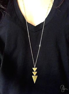 Beautiful long geometric necklace with:  ♥ Dangling gold brass triangles ♥ 16K Gold plated over brass chain ♥ Clasp closure ♥ 5cm / 2 inch long pendant ♥ Chain length - available in different lengths, choose the option that suits you best  - The chain in the picture is 79cm / 31.5 inches long Matching gold triangle earrings: www.etsy.com/listing/177537103 www.etsy.com/listing/172066794 www.etsy.com/listing/184364836 www.etsy.com/listing/177536435   Free shipping offered for most additional…