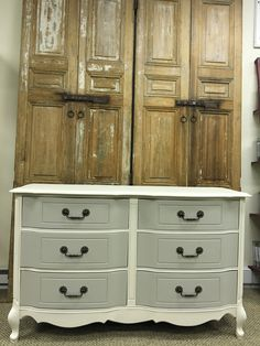 This dresser was painted in a light cream color with drawers painted in light gray. Great piece to add to any space for many options for use.