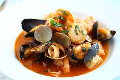 Cioppino...garlicky, tomato-y, yummy seafood soup/stew...relatively few ingredients.