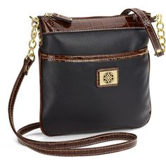 The perfect small compact accessory to help keep all your essentials at your fingertips, this crossbody features a faux leather shell, faux croco trim, gold ton