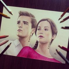 Hermoso dibujo de Katniss y Peeta en Catching Fire!!