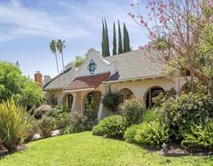 Stunning 50 ft Courtyard with cathedral ceilings & Mission emblem sunburst window with picturesque sunset views.