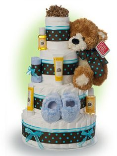 "This beautiful teal blue contemporary design is loaded with the finest ingredients including A Gund™ brand Ultra Soft ""Fleming"" teddy bear and Burt's Bees specialty baby supplies. Only $96.00"