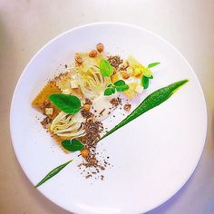 Confit duck and egg yolk filled black garlic/molasses ravioli, celeriac, hazelnuts, fennel chips, parsley coulis, puff rice crumble, and sunflower shoots by @chefbohati #TheArtOfPlating