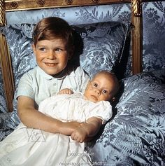 Prince Andrew holding Prince Edward when they were children.