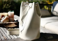 I recently got a new sewing machine and decided that I would make a faux leather purse as my first project of 2014! It's a little more ex...