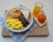 Miniature Breakfast Meal with Orange Juice