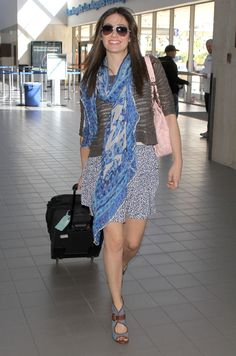 Actress Emmy Rossum arriving for a flight at LAX airport in Los Angeles, CA.2011,Feb.