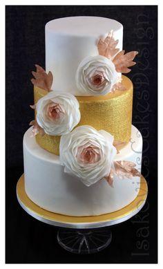 pastel de bodas de oro pantalla con ranunculuses