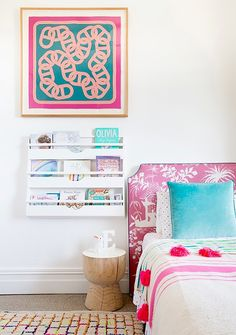 A colorful and preppy bedroom with pink and blue accents