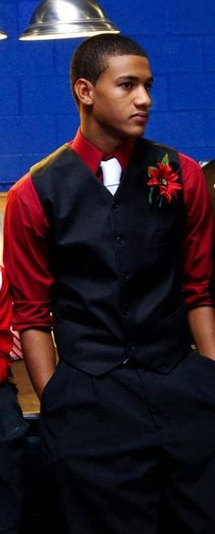 GQ...love the red shirt and red boutonniere on the vest...