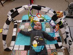 DIY Baby Play Gym. I think Steve cld make this!