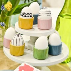 Black and white easter eggs in pastel egg cups for easter. Simple black marker designs.