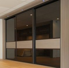 Modern sliding doors wardrobes adding style to your for Back painted glass designs for wardrobe