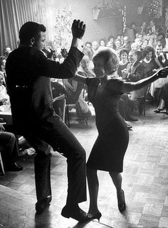 ( - p.mc.n. ) Chubby Checker, originator of 'The Twist', dancing with audience member at the Crescendo nightclub, Hollywood, 1961