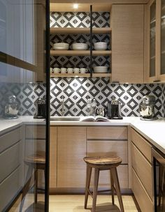 A bold backsplash with under-cabinet lighting looks amazing! With the extra lighting, the bold pattern stands out even more in this small kitchen space.