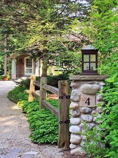 Michigan Cabin Makeover Pretty outside as well as inside Stone pillars and split-rail fencing enhance the rustic setting.Pretty outside as well as inside Stone pillars and split-rail fencing enhance the rustic setting. Driveway Landscaping, Backyard Fences, Garden Fencing, Landscaping Ideas, Pool Fence, Hillside Landscaping, Outdoor Landscaping, Backyard Ideas, Split Rail Fence