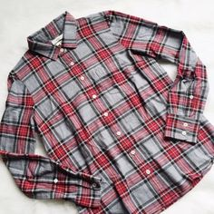 J. Crew Boy Shirt in Grey Tartan Classic tartan plaid. Very soft. Boy fit, size 2. Excellent condition, no damage or signs of wear. ----------- Our signature take on the boyfriend shirt, shaped with seams at the bust for a subtly feminine fit and crafted in a cool grey tartan. Cotton. Long sleeves. Chest pocket. Machine wash. Import. J. Crew Tops Button Down Shirts