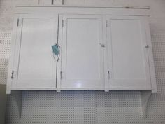 $449 - Primitive wall hanging cabinet with 3 doors - painted in white milk paint - a great addition to any home!***** In Booth H18 at Main Street Antique Mall 7260 E Main St (east of Power RD on MAIN STREET) Mesa Az 85207 **** Open 7 days a week 10:00AM-5:30PM **** Call for more information 480 924 1122 **** We Accept cash, debit, VISA,