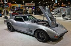 Chevy and Jimmie Johnson teamed up to build this 1971 Corvette, complete with a modern GM Gen V engine from the GM performance catalog. Check out our live pics from the 2014 SEMA Show. Old Corvette, 2014 Corvette, Corvette Summer, Classic Corvette, Chevrolet Corvette, Pontiac Gto, Toyota Camry, Us Cars, Sport Cars