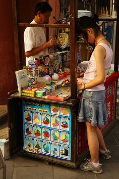 street vendor selling rubix cubes, among other toys, in Chengdu, Sichuan, China