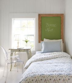 With not an inch to spare, the owner of this Florida cottage pushed the guest room's twin bed against the wall and hung a green chalkboard in place of a headboard. Bonus: The piece doubles as a memo board.