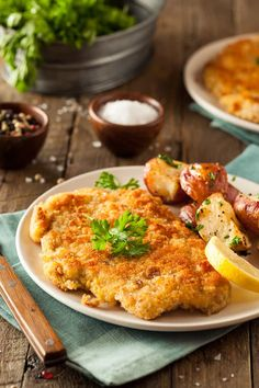 A lightened up homemade, pan-seared German Chicken Schnitzel recipe that's easy to make at home for Sunday Dinner or any night of the week. While veal is the traditional choice for authentic German Wiener Schnitzel, chicken or pork is an easy and delicious substitution. #german #schnitzel #31Daily