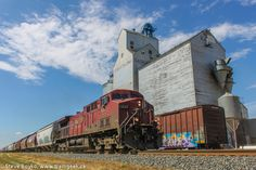 A Canadian Pacific Railway train rolls past the grain elevator in the prairie town of Chaplin, Saskatchewan, Canada | by Steve Boyko, via 500px