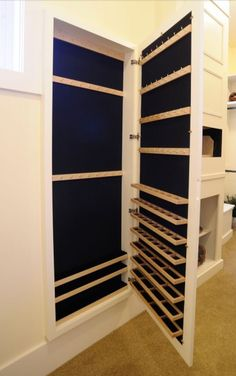 I like this built in jewelry storage.  Could go between the studs in the wall.