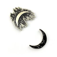 Sun and Moon Duality Set  - Custom lapel pins. - Measures 1 tall (sun), 1.25 tall (moon) & 1.5mm thick. - Soft enamel black fill and a silver metal finish. - Attaches to garments with a single post. - Both rubber and locking security clasps included. - Comes mounted on display card.  Please visit my store at www.exhumedvisions.com  Instagram - @exhumedvisions