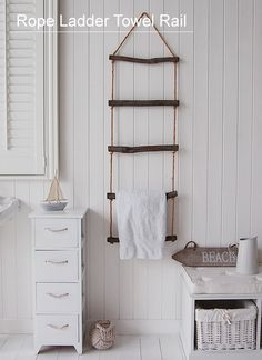 What a great idea! http://www.thewhitelighthousefurniture.co.uk/white-bathroom-furniture/rope-towel-ladder.htm