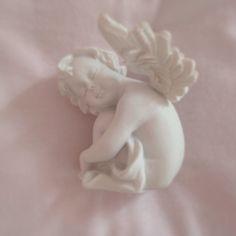 littleimogen: this little angel cherub watches over me when i sleep at night