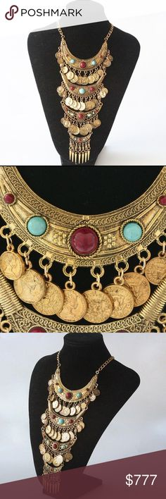 Coming Soon 🔥 Gold-tone Boho Statement Necklace Beautiful gold-tone statement necklace with dark red and aqua colored stones and metal coins. $24 when they arrive Jewelry Necklaces