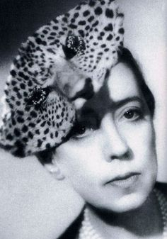 Elsa Schiaparelli. Shows a contrast to her volunteer work and humble opinions. She is here wearing a leopard head, on her own head.