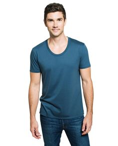 We took our classic slim-fit pima tee and added a modern scoop neck. This one looks great on the beach with shorts, or pair with our resin wash extra slim jeans for a sharp evening look.
