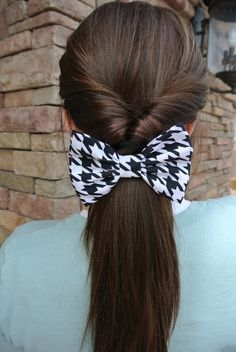inverted pony tail with a big bow