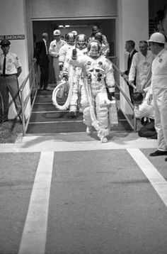 In this July 16, 1969, file photo, Apollo 11 commander Neil Armstrong gives a thumbs up signal as the three Apollo astronauts walk to the transfer van en route to the Saturn Five rocket ready to blast off for the moon, July 16, 1969, Cape Kennedy, Fla.