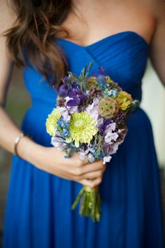 Blue bridesmaid dress and bouquet with hints of blue