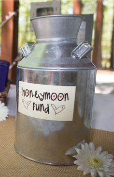 Honeymoon fund collection jar instead of a tin. Putting one of these at the reception
