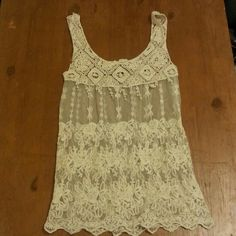 Rachel and Chole lace tank Cream colored lace tank.details from top to bottom. Very delicate. Shows a tiny amount of wear in the bits that hang down but hardly noticeable.  Beautiful! Rachel and Chloe Tops Tank Tops