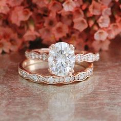 Moissanite wedding ring bridal set showcasing solitaire engagement ring set in a…