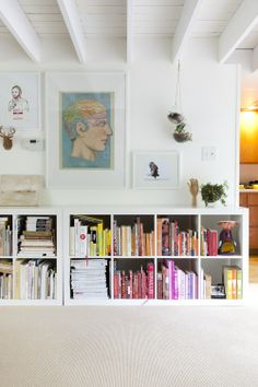 I love the idea of low book shelves and artwork above.