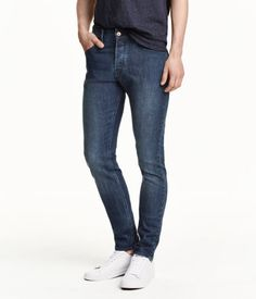 5-pocket, low-rise jeans in washed stretch denim with ultra-slim legs. Button fly.